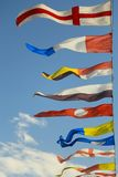 Military naval flags against the sky Stock Photography