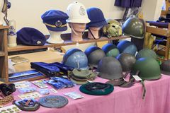 Military, naval, and police headwear on display royalty free stock images