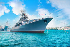 Military navy ship in the bay. Military sea landscape with blue sky and clouds Royalty Free Stock Photography