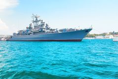 Military navy ship in blue sea. With sky and clouds Royalty Free Stock Images