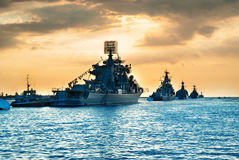 Military navy ships in a sea bay. At sunset time Royalty Free Stock Images