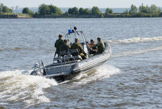 Military Navy Training. Navy Paratroopers. boat leaves training Stock Photography