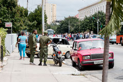 Military observes crowds on President Obama route in Havana, Cuba 2016 Stock Photos