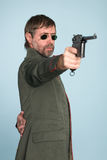 Military officer fires a gun Stock Image