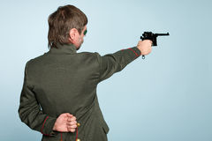 Military officer fires a gun Stock Photo