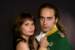 Military officer and his lady. Portrait of a military officer in uniform of the 18th century posing with his lady Royalty Free Stock Photos