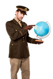 Military officer pointing something on globe Stock Photos