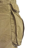 Military olive green army style cotton twill cargo pants storage stock photography
