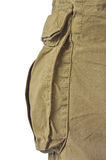 Military olive green army style cotton twill cargo pants storage pocket isolated macro closeup, large detailed camouflage trousers Stock Photo