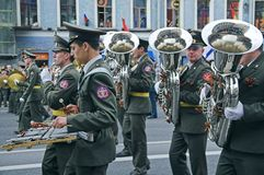 Military orchestra musicians parading Stock Photos