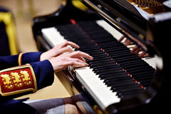 Military orchestra piano performance detail Royalty Free Stock Photo