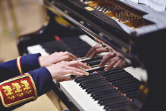 Military orchestra piano performance detail Stock Images