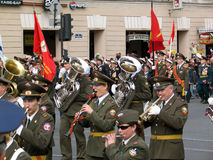 Military orchestra walking on the street playing Stock Images