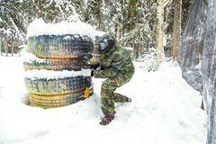 Military paintball training in winter with much snow. Military paintball training in winter forest Royalty Free Stock Images