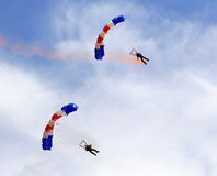 Military parachute jump celebration. Paragliders descending in a military skydiving parachute demonstration Royalty Free Stock Photos