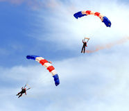 Military parachute jump celebration. Paratroopers descending in a military skydiving parachute demonstration Royalty Free Stock Photography