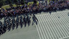 The military parade. Aerial photo. Army soldier walking. Aerial photo Parade stock footage