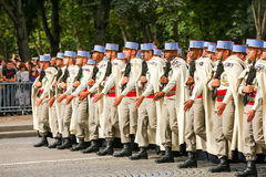 Military parade (Defile) during the ceremonial of french national day, Champs Elysee avenue. Royalty Free Stock Photo