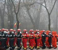 Military parade - firemen. Firemen in different uniforms marching for the national day Royalty Free Stock Photography