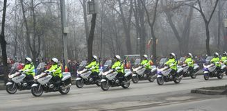 Military parade - policemen. Policemen riding motorcycles marching for the national day Stock Photo