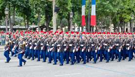 Military parade in Republic Day (Bastille Day). PARIS - JULY 14: Army columns marching at a military parade in the Republic Day (Bastille Day) on the Champs royalty free stock photos