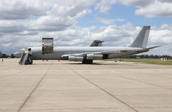 Military Passenger Plane. At an airbase Royalty Free Stock Photography