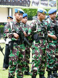 Military patrol. Military briefing prior to a patrol in anticipation of a terrorist attack in the city of Solo, Central Java, Indonesia royalty free stock image