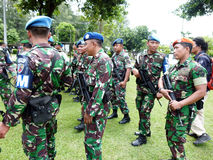 Military patrol. Military briefing prior to a patrol in anticipation of a terrorist attack in the city of Solo, Central Java, Indonesia royalty free stock images