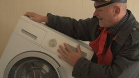Military pensioner receives social assistance from state. human eye is covered with black medical patch. New washing machine. Of latest modification. Veteran stock video
