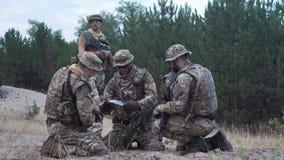 Military people navigating on battlefield stock footage