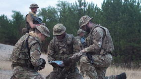 Military people navigating on battlefield stock video
