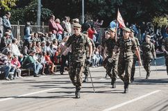 Military people parading at the celebration of the 119 years of. Campo Grande, Brazil - August 26, 2018: Civic Parade desfile civico at 13 de Maio street stock images