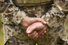 Military person holding hands behind his back Stock Photos