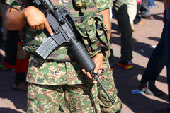 Military personnel holding assault rifle Royalty Free Stock Photography