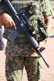 Military personnel holding assault rifle - Series 2 Stock Image