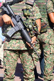 Military personnel holding assault rifle - Series 3 Stock Photography