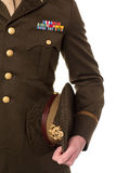 Military personnel holding his precious cap Royalty Free Stock Image