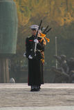 Military personnel, South Korea. View of a line of soldiers from South Korea in Seoul in a drill formation with weapons, with war memorial in the background Royalty Free Stock Photo