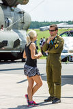 The military pilot and a girl. Royalty Free Stock Photos