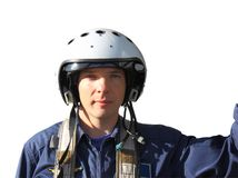The military pilot in a helmet. In dark blue overalls separately on a white background Stock Image