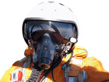 The military pilot in the plane. In a helmet in dark blue overalls against the blue sky Stock Images