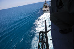Military pilot soldier on helicopter. Helicopter view on the sea Royalty Free Stock Photos