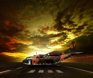 Military plane on airport runway against beautiful sun rising sk stock photography