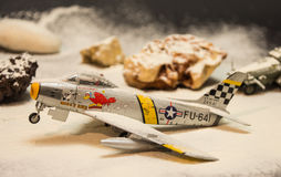 Military plane. Miniature military plane in snow Royalty Free Stock Images