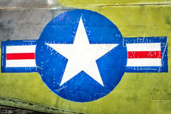 Military plane with star and stripe sign. Stock Photography