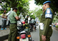 Military police. Conduct raids against soldiers who violate the discipline in the city of Solo, Central Java, Indonesia Royalty Free Stock Photography