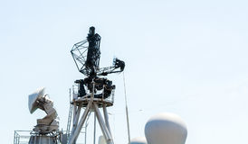 Military radar air surveillance on navy ship. Battle ship antenna Royalty Free Stock Photo