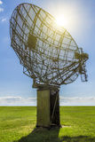 Military radar field. Military radar in the field on a background of blue sky and sunlight royalty free stock photo