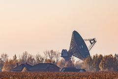 Military radar at sunset. Military radar at sunset located in the meadow stock photography