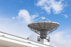 Military radiolocator station with parabolic radar antenna dish Stock Photos